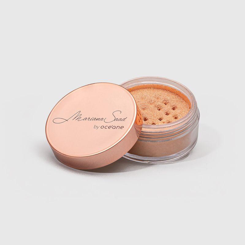 Iluminador Facial Rosa Mariana Saad Skin Shine Rose Gold embalagem aberta tampa externa ao lado esquerdo