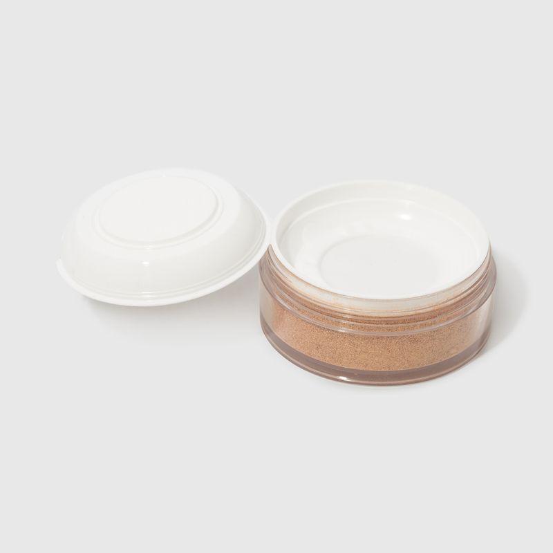 Iluminador Facial Dourado Mariana Saad  Skin Shine Gold aberto tampa interna ao lado esquerdo verso